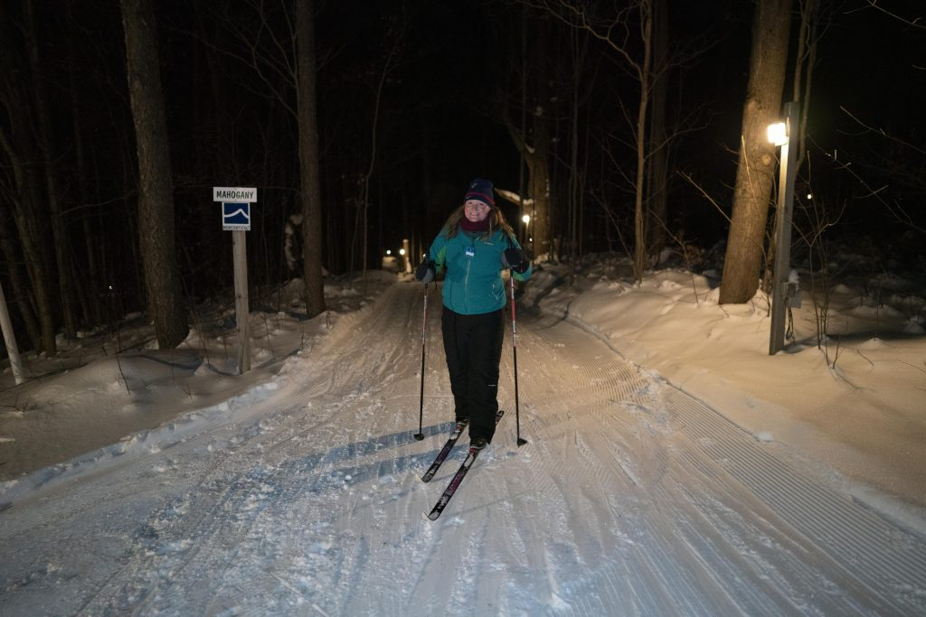 Lady cross country skiing at Byrncliff, Varysburg, NY